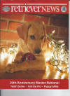 Ally on the cover of December Retriever News -  Owners Dave and Deana Wolfe and Bob and Barbara Hayden